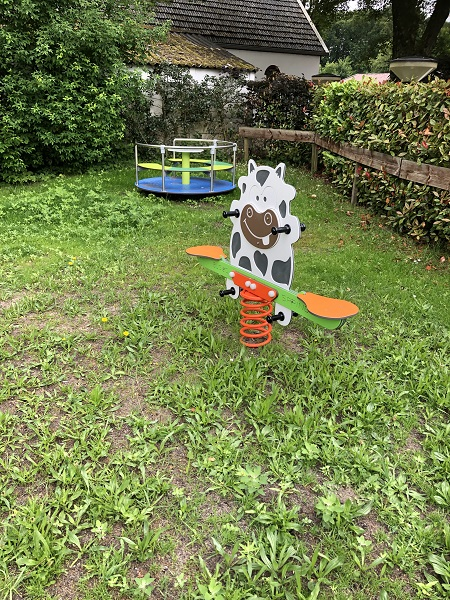 Veerwip koe en draaimolen